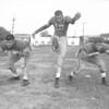(09.13.53) Mount Carmel Catholic football players are Edward Hozida, Tom Concavage and Joe Swatski.