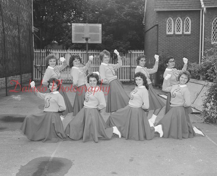 (1959) Mount Carmel Catholic High School cheerleaders are, front row, from left, Roberta Thompson, Mary Carle, Mary Ann Michalowski and Virginia Burns; back, Dorothy Croker, Judy Davis, Roberta Long and Antoinette Scicchitano.