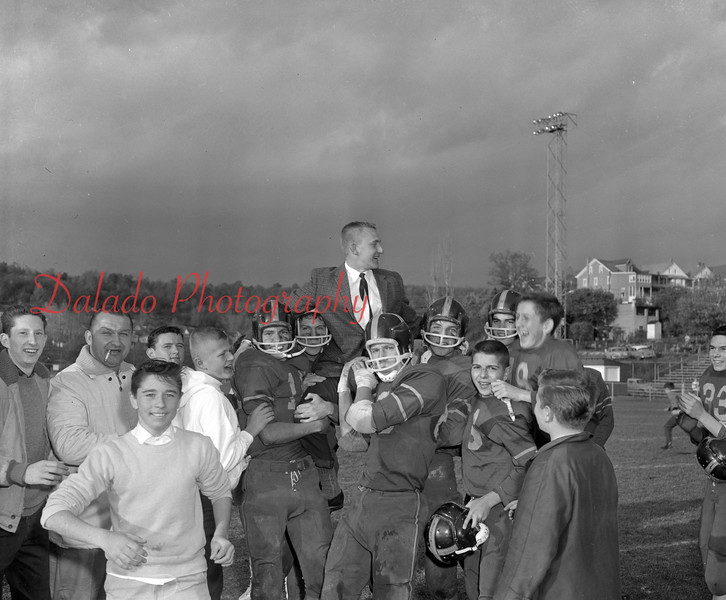 (1962) Mount Carmel Catholic High School football players hoisting coach Bob Oravitz on their shoulders after clinching the Rams first Anthracite League football title.