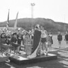 (April 1960) Marilyn Baynham is crowded Field Day Queen at the annual track meet. Bestowing the crown is Steve Bolick while Jim Trione presents the queen and her court with gifts. Members of the court are Irene Moleski, Carol Andzema, Rose Raynal, C. Smith, Elaine Bridy and Barbara Greco.