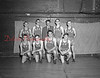 (04,24.1952) Mount Carmel High School Track Team on April 24, 1952. Pictured are, front row, from left, Bob Getridge, Gene Every, Joe Rosinko and Ray Savage; standing, Bob Sokol, Paul Roadarmel, Coach Jerry Breslin, Bill Wislock and Tom Zarko.