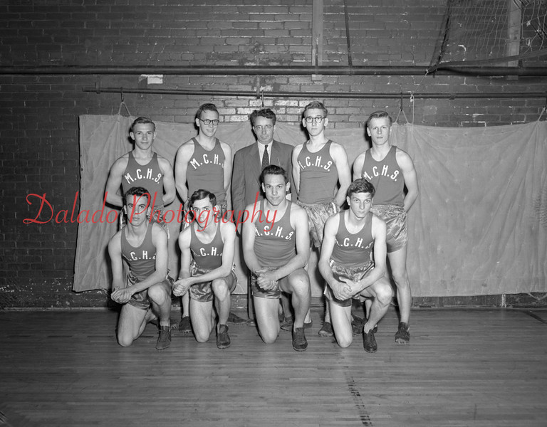 (04,24.1952) Mount Carmel High School Track Team on April 24, 1952. Pictured are, front row, from left, Bob Getridge, Gene Every, Joe Rosinko and Ray Savage; standing, Bob Sokol, Paul Roadarmel, Coach Jerry Breslin, Bill Wislock and Tom Zarko.