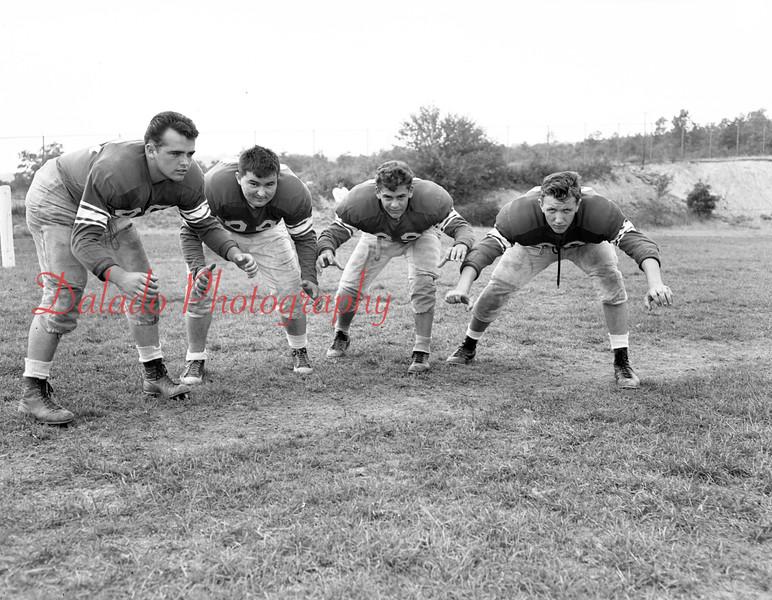 "(1955) Kulpmont High School football ""The Forward Wall."" Pictured are, from left, Joe Alonza, Gib Domanski, Joe Cesari and Tony Swatski."