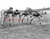 "(1955) Kulpmont High School football ""The Forward Wall."" Pictured are, from left, Joe Alonza, Gib Domanski, Joe Cesari and Tony Swatski."