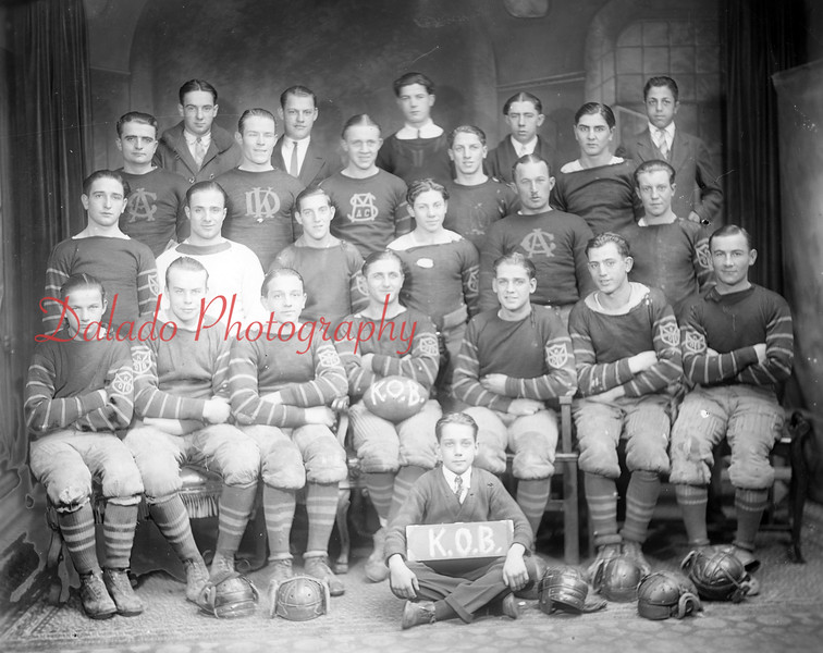 """The Kulpmont Orange Buds were Class """"C"""" Champions of the South Anthracite region in 1927, a league comrpised of teams from Shamokin to Shenandoah. Their opponents that year were the Atlas Wolves, Brady Wildcats, Marion Heights Indians, Mount Carmel Maroons, Shenandoah Red Jackets, Glover Hill Buffaloes, Shamokin Marshalton A.C., Lost Creek, MacAdoo and Trevorton. Coach was J. Backus. Members of the team were, front row, from left, Walter """"DeKalb"""" Kalbarczyk, Joseph Washko, Michael Orlando, Andy Feudale, Fred Dallabrida, Paul Veach and Mike Mascolic; second row, Louis Yob, Albert """"Buffalo"""" Avellino, Daniel Scanzoni, Ralph Bridy, John """"Yellow"""" Washko and Marino Scanzoni; back, Emory Getchy, Michael """"Red"""" Stewart, Joseph Lutz, Joseph D'Alexander, and Jimmy Feudale; back, John """"Lefty"""" Lancasky, Frank Shaulinski, Tony Varano, Vince Carroll and Hanibal """"Nibbles"""" Mirarchi. Team mascot was Edward Dallabrida, owner of Dal Art Studios."""