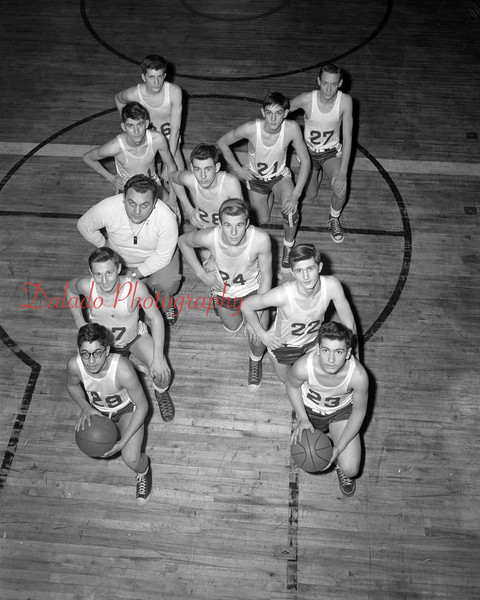 (01.18.53) Kulpmont basetball team are, lower left to right, D. Feudale, Ed Wasacavage, Ed Stavinski (coach), Stan Chesney and Stan Daniels; bottom right, M. Gard, Jerome Marshalek, Ed Yablonski, Joe Witowski, Joe Gencavage and Frank Ziegler.