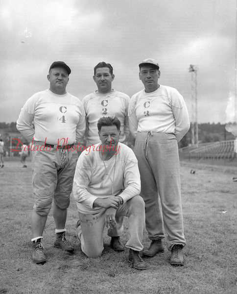 (09.08.55) Mount Carmel High School football coaches are, kneeing, head coach Mike Terry; back, Charles Kailow, George Wrona and Victor Dall.