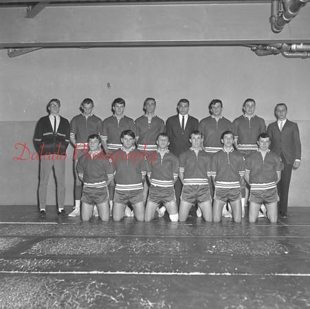 (1966) Mount Carmel High School hoops team are, front row, from left, Frank Niglio, Harry Brennan, Jake Wojcik, Greg Doviak, Gerry Delany and Joe Woytowich; back, Joe Chesney, Ron Butkera, Joe Buchinski, Mike Mychak, Coach Bob Varano,  Earl Maurer, Jack Kehler and Rich Americk.