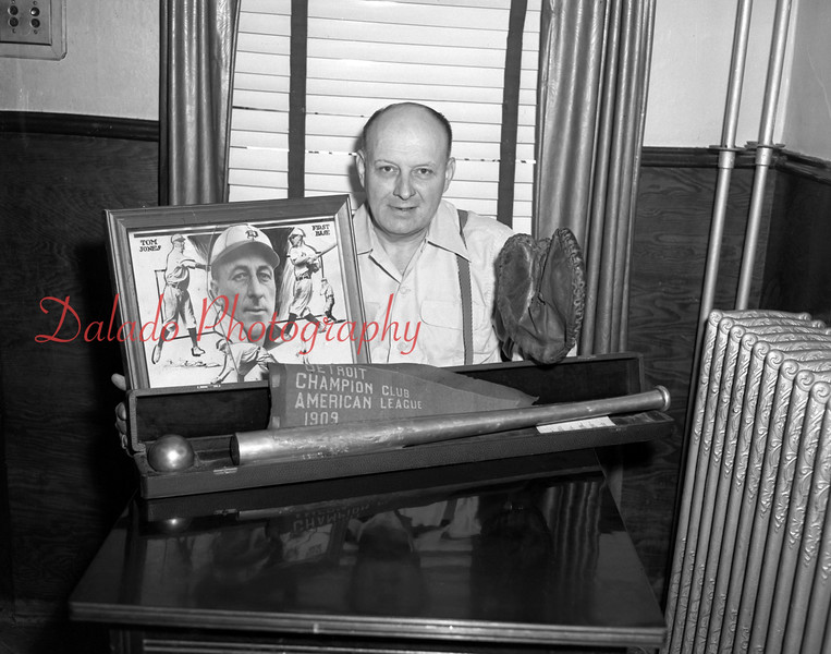 (07.08.54) Ralph Jones, Locustdale, shown with his father's baseball mitt, which he used when he played with the Detroit Tigers.