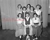 (09.18.52) Candidates for Football Queen are Mary Anna Apple, Mary Ann Shamanski and Betty Jane Moore; standing, Delores Deraba, Sylvia Ann Poplaski, Joyce Hoover, Rosalie Milbrand and Anna Mar Bohr.