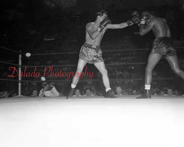 (07.23.53) Mount Carmel's Johnny Lombardo fights Gil Turner of Philadelphia on July 23 at Hershey Sports Arena.