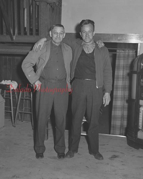 (02.25.54) Shuffleboard champs are Art Minnick, left, and Frank Betz.