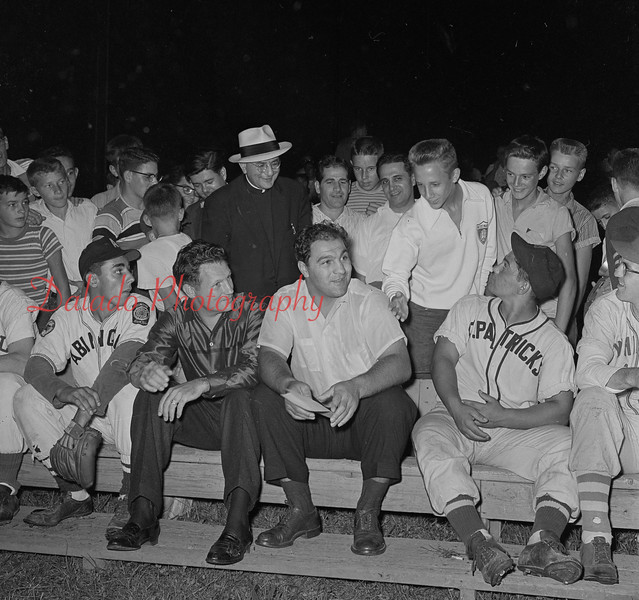 (9.6.56) Rocky Marciano, right, with Francis Genglie, when the retired heavyweight champion visited the area. Rocky brought his Brockton Blockbusters baseball team to Kulpmont.