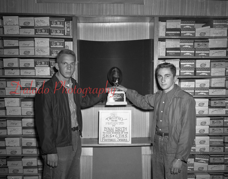 (1951) BNA Brith with a trophy that will be given to winner of the Shamokin/Coal Township high schools football game.