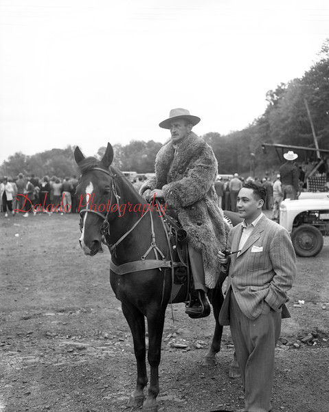 (10.15.53) Annual Kiwanis Horse Show at Mt. Poco, off Trevorton Road. Key officials of the hose show watch intently as the event gets underway. Riding the western hose is Darwin Feese, general manager of the hose show. Standing is Attorney Myron Moskowitz, general chairman of the annual event.