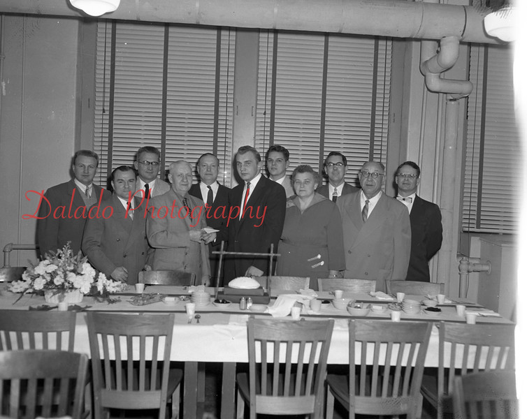 "(01.20.55) Testimonial dinner for Johnny Gurski who won honorable mention on the All-American selections as a lineman for the University of Pennsylvania. Pictured are, front row, from left, Elmer ""Tim"" Shuey, president of the Coal Township boosters; J. Purdon Boyd, John Gurski and Mr. and Mrs. John Gurski; second, Bernie Romanoski, Walt Marshall, Judge William Troutman, Jim Kapenhauer, Mack Olley and Alvin Thomas. Jim Kopenhaven was a classmate of Gurski's at the university."