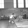 (March 55) Coach Andy Silock watches Kenny Black and Robert Stutz in a inter mural wrestling tournament.