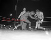 (August 1954) Johnny Saxton, 156, leading contender for Kid Gavilan's welter crown, takes on Johnny Lombardo, 152, Mt. Carmel, at the Mount Carmel High School Stadium. The decision was a split.
