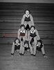 (12.11.58) JV basketball and wrestling cheerleaders are, front row, from left, Gayle DePerro, Betsy Reese and Janice Jenkyn; second, Dale Bernstein and Edyie Deppen; top, Kay Williams.