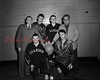 (01.10.52) Shamokin High School basketball are, bottom, from left, Dick Patry and Florian Dennis; standing, Frank Van Devender, coach of the Greyhounds; Julian Sopp, Alzaremba and Coach Walt Marshall.