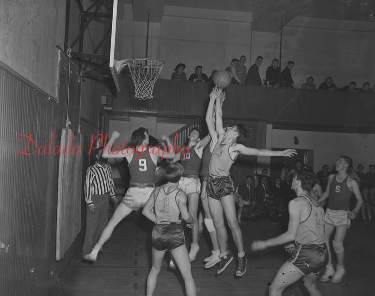 (Jan. 1951) Basketball game, unknown gym.