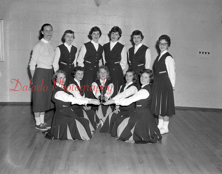 (03.28.57) Cheerleaders of SHS cheerleaders display a trophy they won during a recent basketball tournament. Pictured are, from left, Marian Rohrer, Barbara Edwards, Linda Romanoksi, Judy Lynch and Betsy Thomas; standing, Mary Jane Markefka, Sonia Wallick, Marilyn Deibler, Mildred Deibler, Nancy Osman and Judy Keiser.