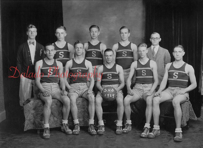 "1929-30 Shamokin High School boys' championship basketball team- Team members are, front row, from left, Ray Kaseman, ""Pete"" Farrow, Fred Lark, Bill Wood, captain; and Joe Evans; back, Frank Omlar, manager; George Thomas, Francis Gillespie, Paul Harris and Ben Thomas, head coach."