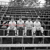 (09.05.57) Greyhound mentors at Edgewood Stadium are, from left, Ward Lichtel, assistant coach; Lou Sarrentino, head coach; Mal Paul and Harold Thomas, assistant coac