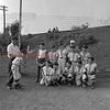 "(08.01.1957) Brady little league baseball team on Aug. 1, 1957. Shown is Stanley Janaski, coach of the little league team, instructing Don Fegley on the correct batting position. Also pictured are, front row, from left, Teddy Yashinski, John Kwasnoski, Butch Bendas, Giles Bartal and Bob Ciesluk; second, Gerald Marcincavage, Norman Pahutka, Robert Romanokski, Frank Feudale, Matty Korluck, and Ed ""Hoople"" Markowski, assistant coach."