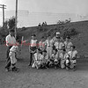 "(08.01.1957) Brady little league baseball team on Aug. 1, 1957. Shown is Stanley Janaski, coach of the little league team, instructing Don Fegley on the correct batting position. Also pictured are, front row, from left, Teddy Yashinski, John Kwasnoski, Butch Bendas, Giles Bartal and Bob Ciesluk; second, Gerald Marcincavage, Norman Pahutka, Robert Romanokski, Frank Feudale, Matty Korluck, and Ed ""Hoople"" Markowski, assistant coach."