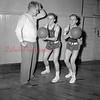 (12.20.1951) Coach Walt Marshall with identical twins, Johnny and Eddie Duda, on Dec. 20, 1951.
