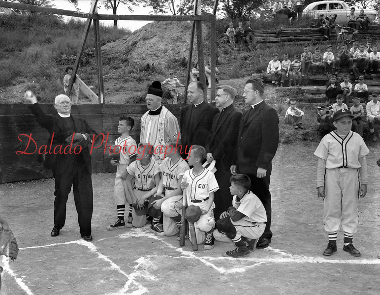 (06.07.56) Mons. Dennis Reardon, paster of St. Joseph's Church, throws the first ball officially to open the 1956 Catholic PeeWee Baseball League. Pictured are, from left, Rev. Celestine Rozewicz, St. Stans; Rev. Emil MayChazak, St. Stephens; Mons. George Mulcaky, St. Eds., and Rev. John Labor, St. Joe's. Team captains are Ken Lark, Alvin Balchunas, Paul Metrocavage, Ronald Zyla and Harry Pappas.