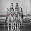 (03.28.57) St. Stan's basketball team are, front row, from left, Robert Fedorko, Fred Segedy, Warren Thoma and Ronald Nye; second, Joe Iwanski, Joe Senulis, Alvin Balchunas and Arnold Patynski; third, Joe Mack, coach; Carl Alley, assistant coach; and Father Felix Comeau, spiritual adviser.