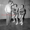 (12.20.1951) Coach Walt Marshall with identical twins, Johnny and Eddie Duda, on Dec. 20, 1951.