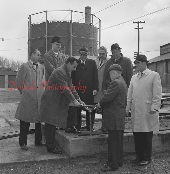 (03.31.66) Gas company officials.