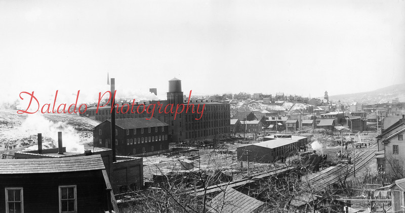 With eyes on the future, the brothers decided on a gigantic expansion. They engaged the services of Shamokin Lumber Company to erect a plant in Kulpmont in 1916. Plans for The Mill were started in 1915 when the Eagles purchased the property occupied by the John Mullen Iron Foundry at a cost of $65,000. (The Shamokin Print and Dye Works, left, and Academy Hill, center, is seen in this photo.)