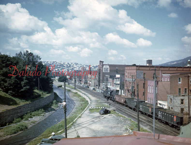 Water Street before the track on the right (the one with the train) was removed. *Did you see the guy working on the utility pole?