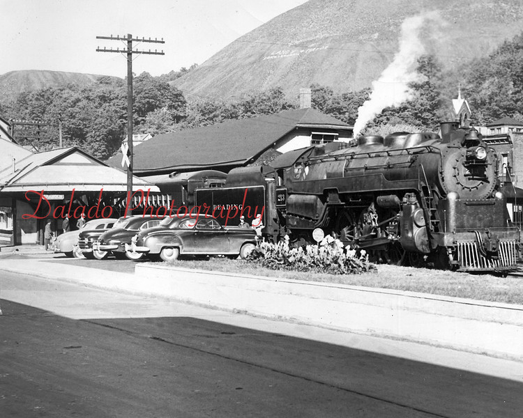 "(9.24.1949) ""King Coal,"" a passenger service train operated by Reading Railroad, pulls out of the Reading Railroad station along Independence Street for its maiden trip on Sept. 24, 1949. Paid passenger service ceased in Shamokin on June 28, 1963."