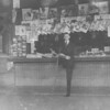 Old photo of a man at a newspaper stand at the Reading station in Shamokin.