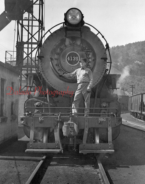 (1946) O.D. ( Oliver Daniel) Milbrand standing on the pilot of his engine in Shamokin Yard (where Weis is now) on the day he retired in 1946.