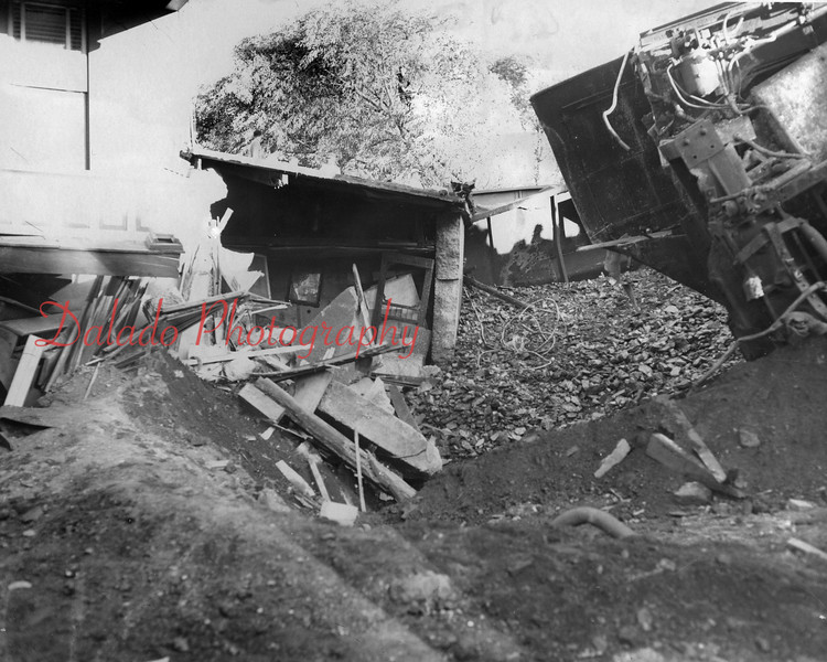 (09.22.1953) Wreck of Yard and Mine crew, Engine 5256, at 1:05 a.m. on Sept. 22, 1953, on the Scott Branch at the end of Third Street in Ranshaw.
