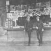 Old photo of men at a newspaper stand at the Reading station in Shamokin.