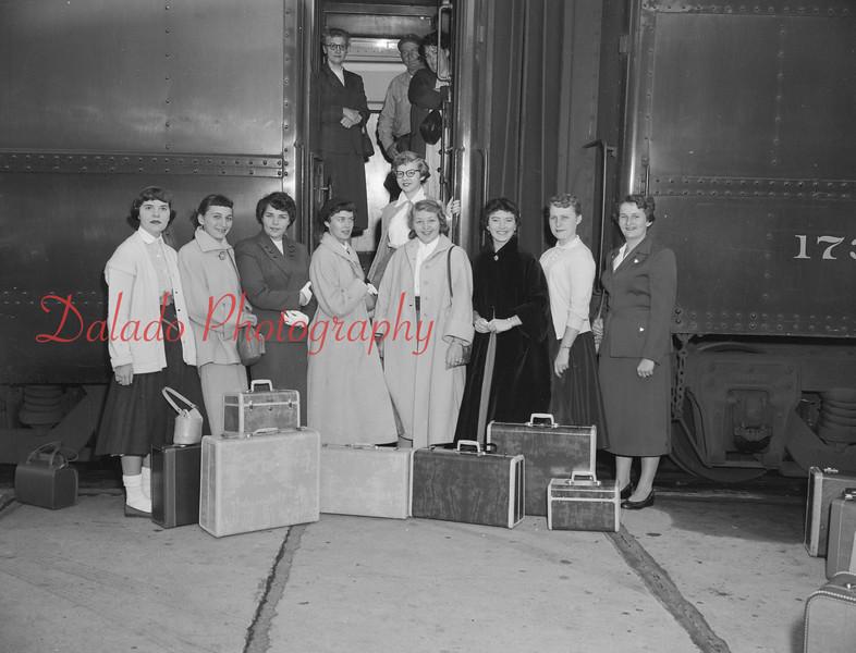 (Sept. 1954) Ladies boarding a train.
