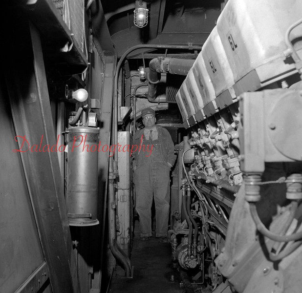 (Oct. 57) Engineer inside a train.