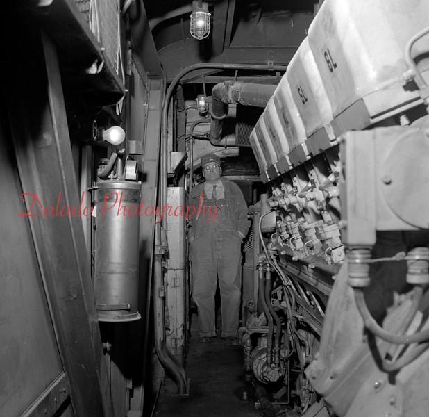 (Oct. 57) Engineer inside a train.