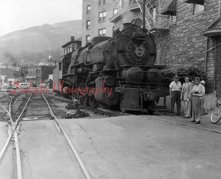 People gather around a train at the intersection of Shamokin and Independence streets.
