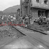 (July 1954) Men removing some tracks at the crossing at Shamokin and Independence streets.