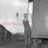 (Aug. 29, 1952) Harry Reese, a conductor for the Pa. Railroad, works on a train on his last day on the job after 52 years of service. Shown in the background is the Glen Burn Colliery.