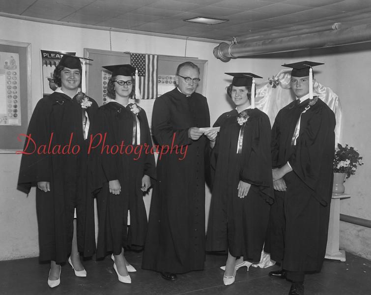 Priest and graduates.
