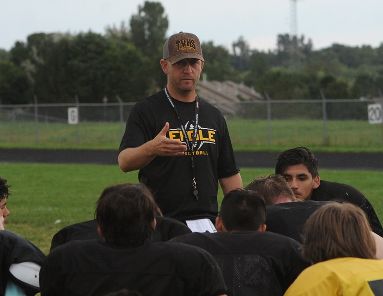 Thompson Valley football coach Matt Smith addresses his team after a recent practice at TVHS.